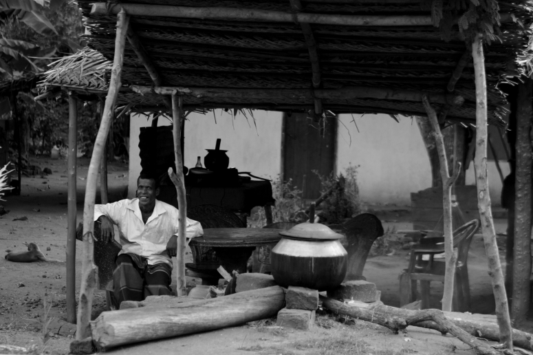 Villager selling boiled corn and Ceylon tea by the road
